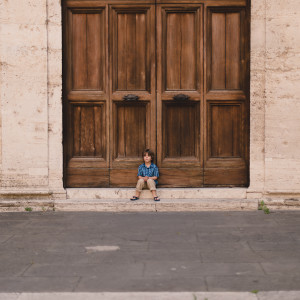 Child sitting on steps in travel Image by Megan Cieloha Photography