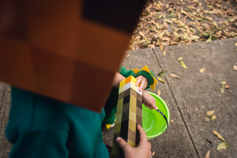 children dressed up for halloween with minecraft torch
