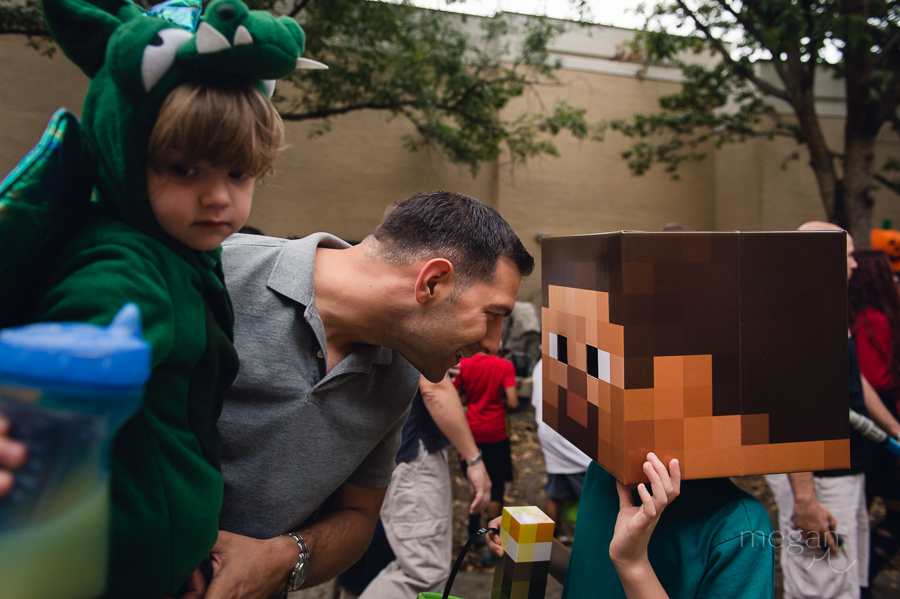 Dad with children dressed up for halloween as dragon and minecraft steve