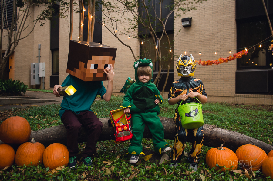 Children dressed up for halloween as minecraft steve, a dragon and bumblebee transformer