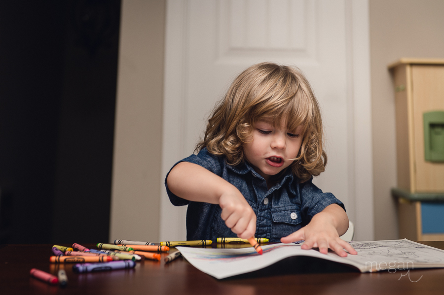 Young child coloring in a book