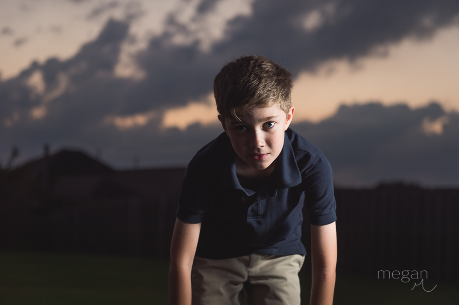 boy in front of sunset, lit by off camera flash