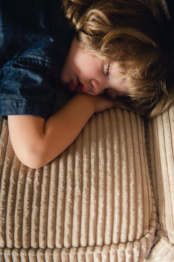 Toddler boys sleeps in natural light