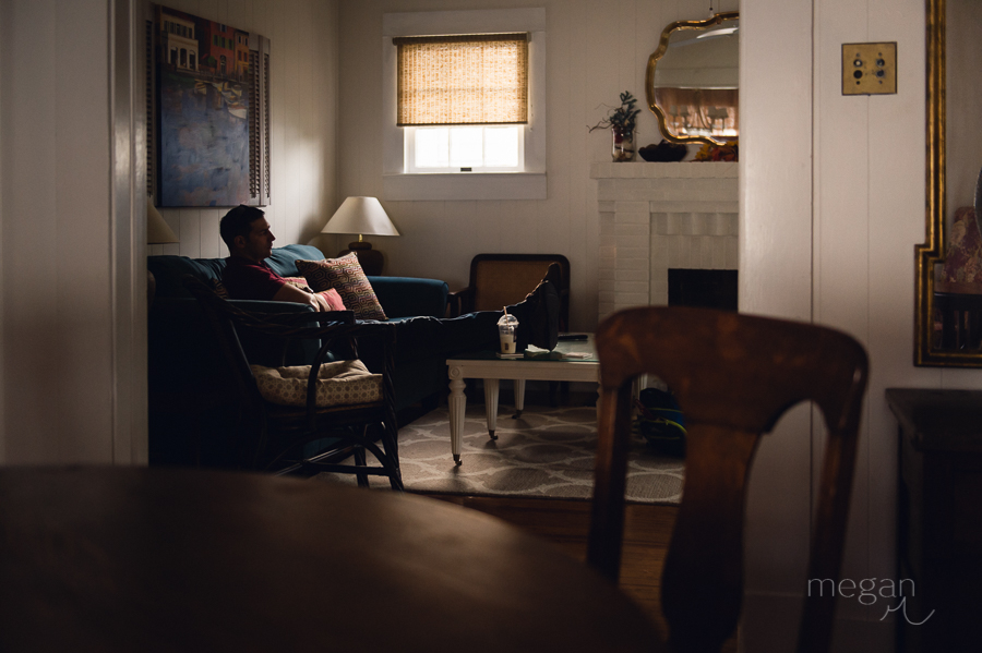 man in cottage living room in late afternoon natural light