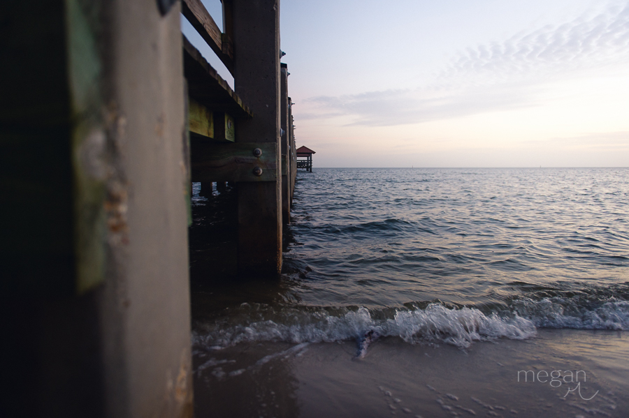 photo from beside a pier during sunset