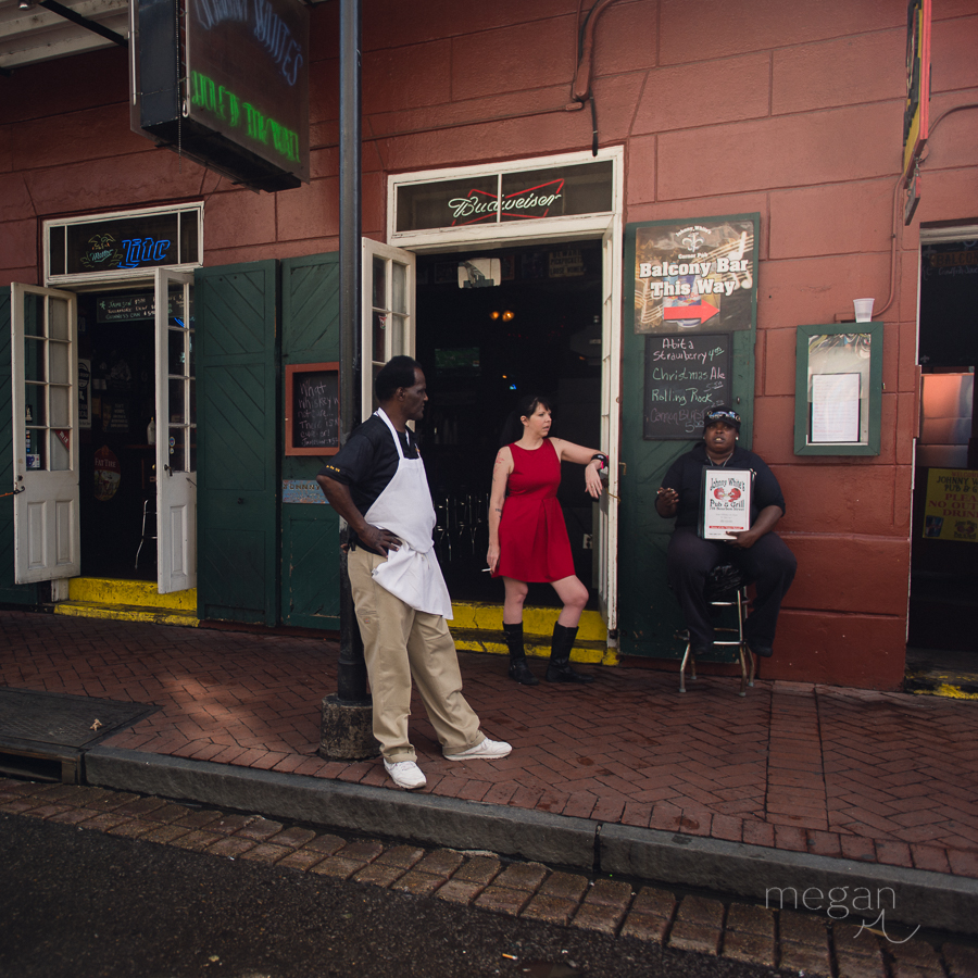 employees stand outside of a restaurant in the french quarter of new orleans