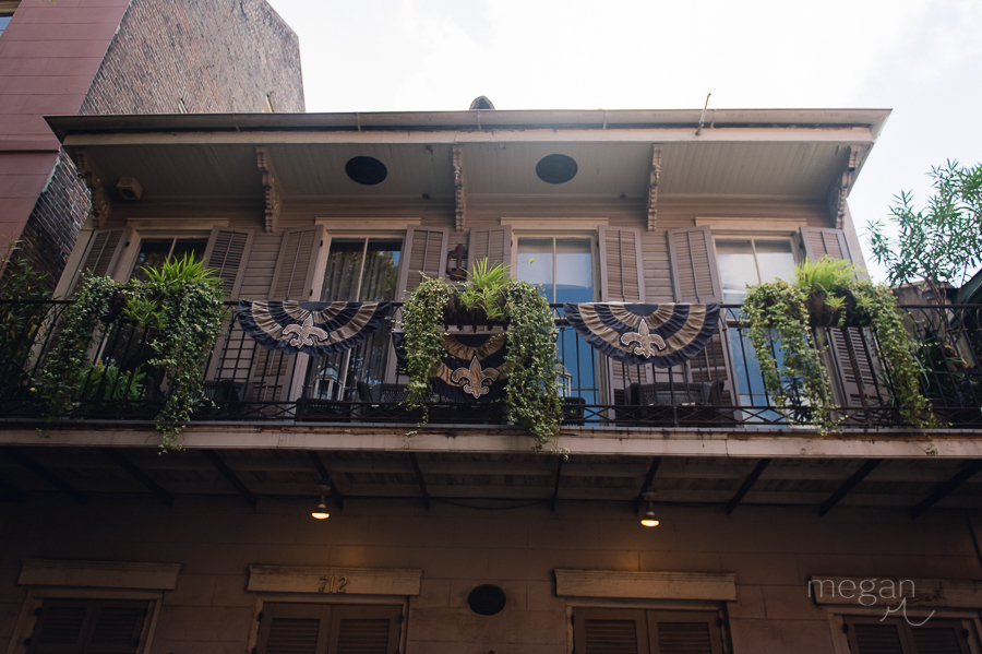 balcony with banners in the french quarter of new orleans