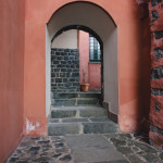 red stucco walled building image by Megan Cieloha Photography