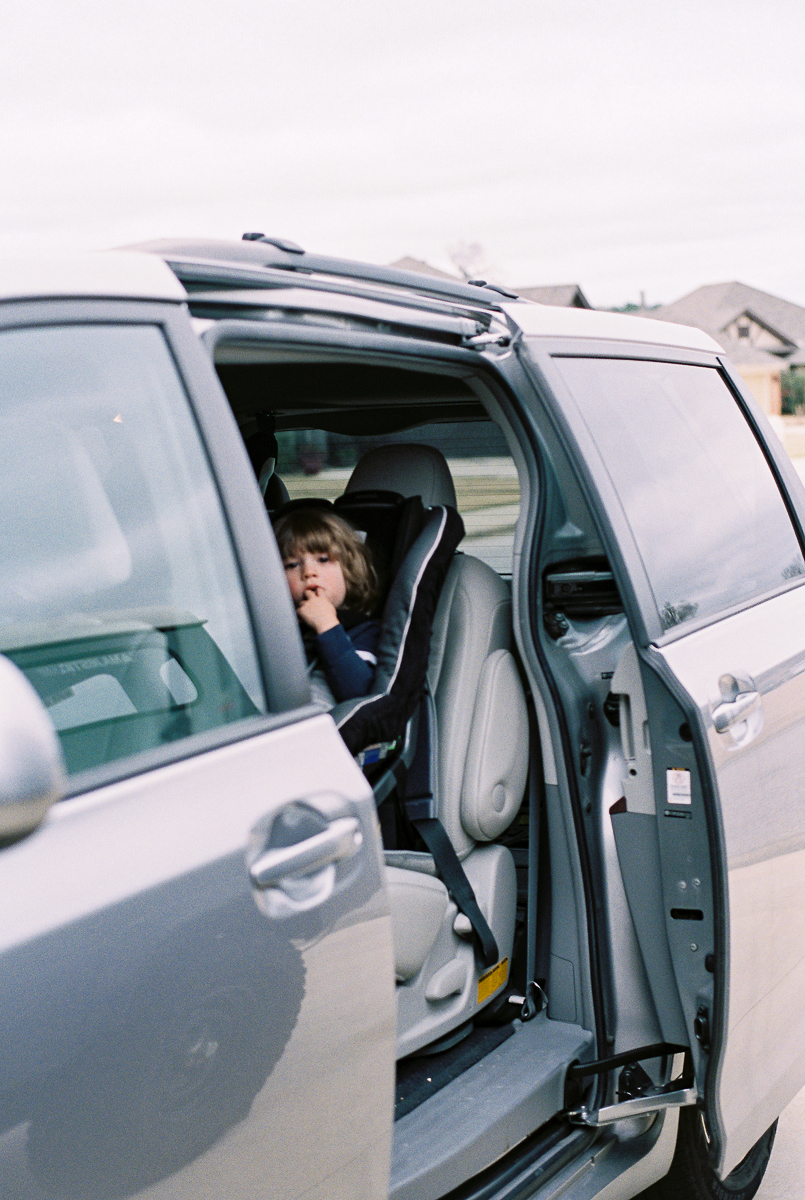 child in van on fuji 400h film photo shot on nikon fe by megan cieloha photography