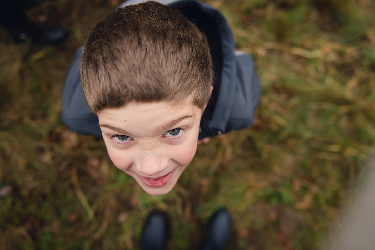 portrait of young boy with a wide angle lens by megan cieloha