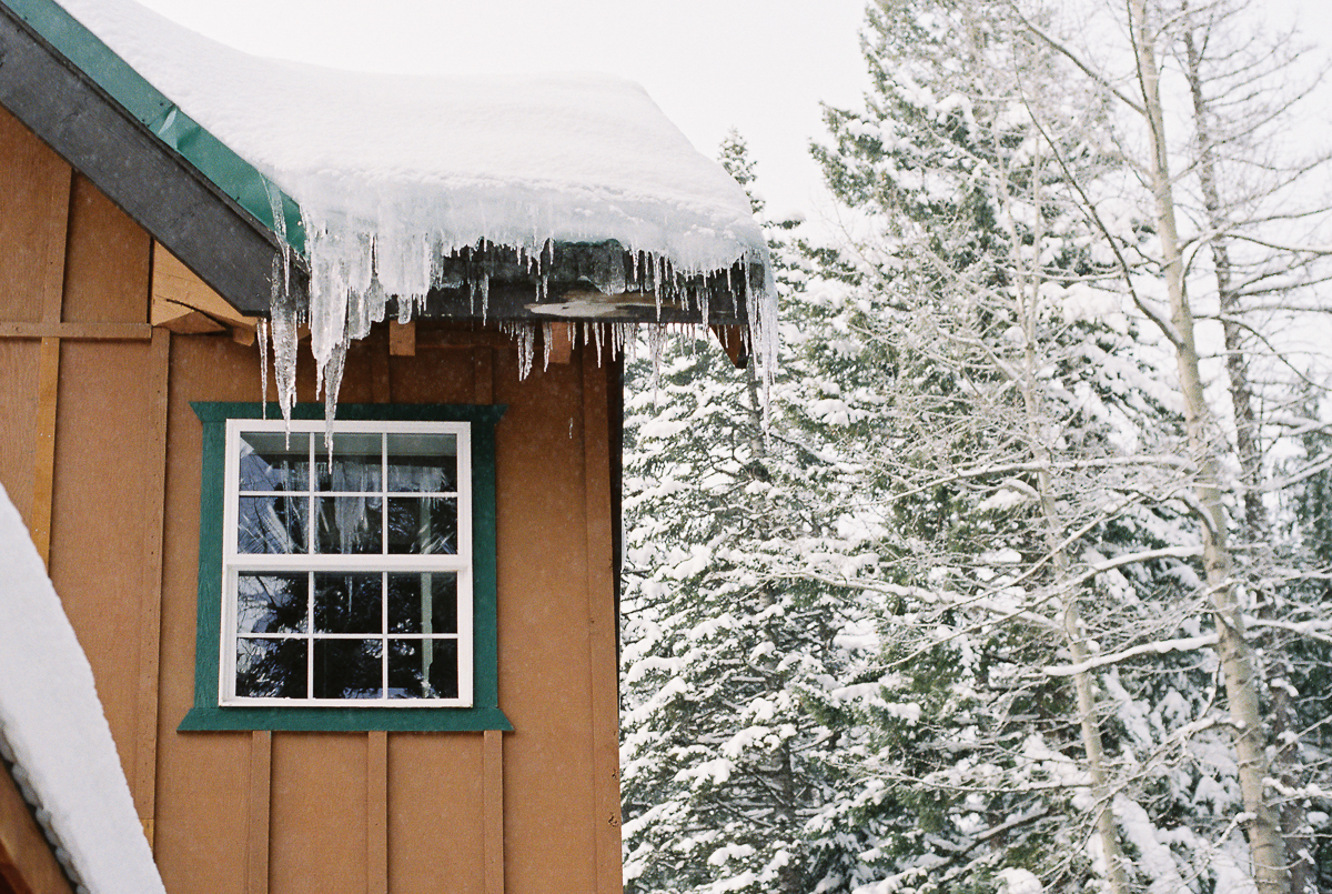 snow and icicles on ski lodge on super 800 film by megan cieloha