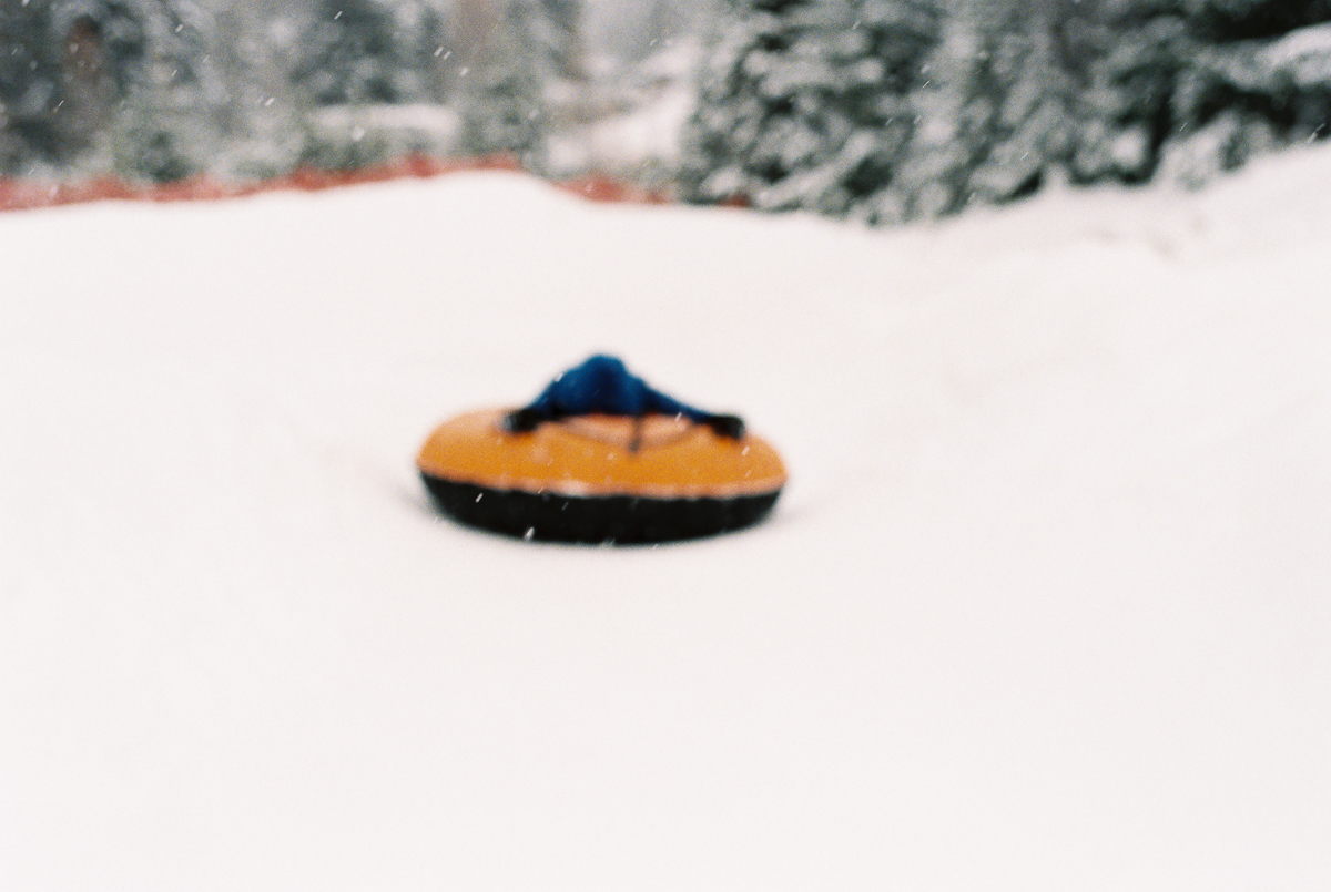 purposeful soft focus of inner tube on snow on fuji superia 800 film by megan cieloha