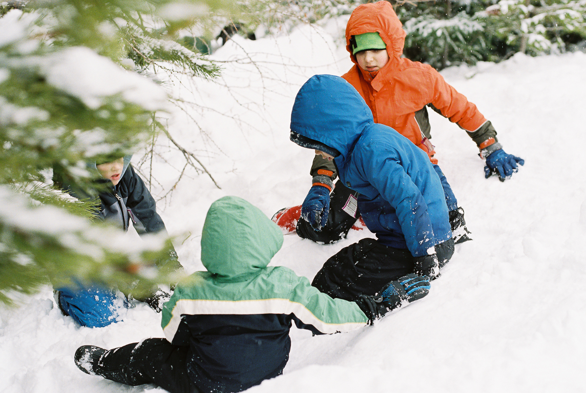 boys play in snow on fuji super 800 film by megan cieloha