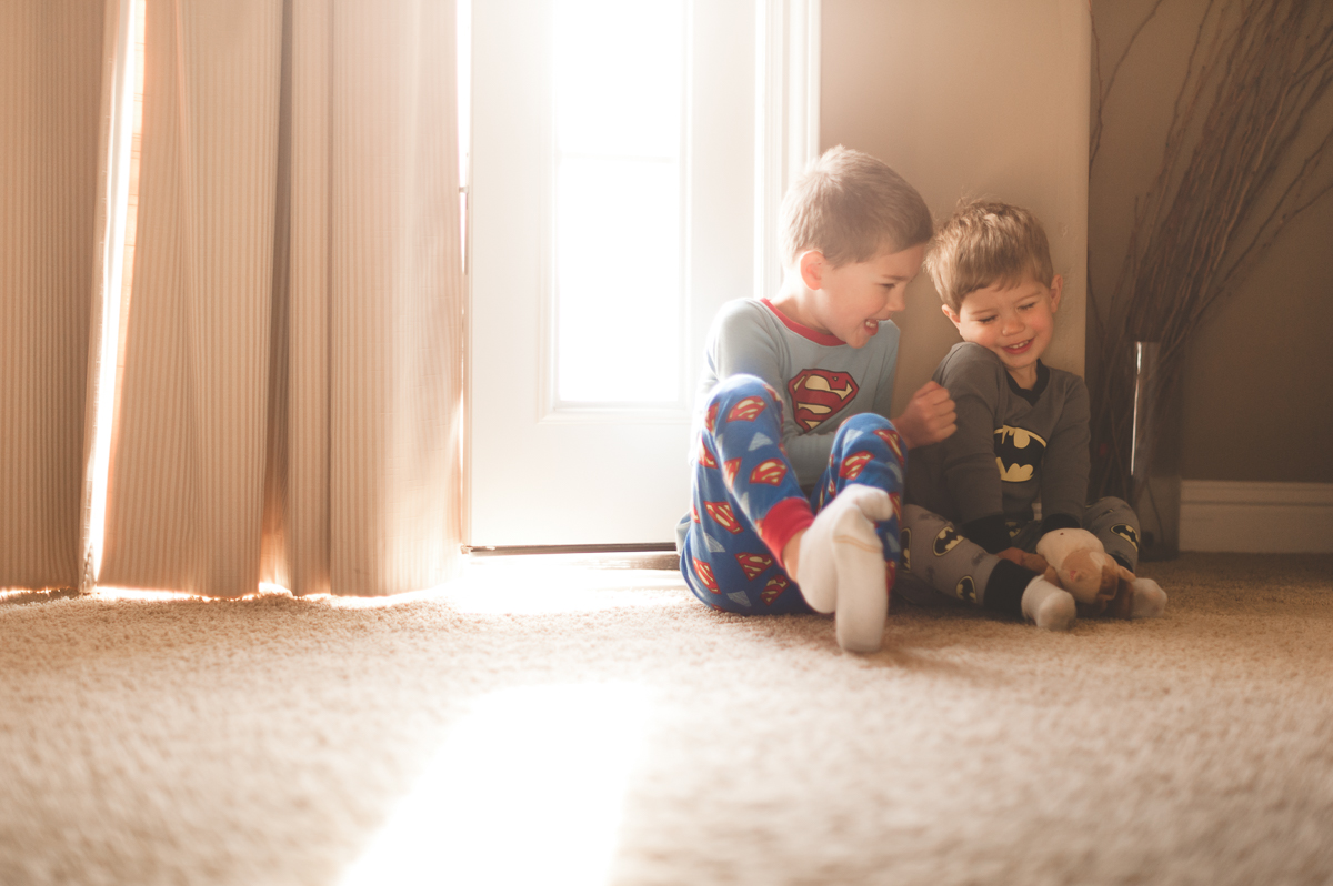 photo of brothers giggling together in pajamas by megan cieloha