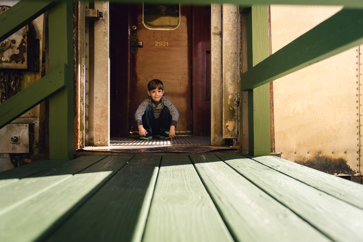 boy in front of train door photo by megan cieloha