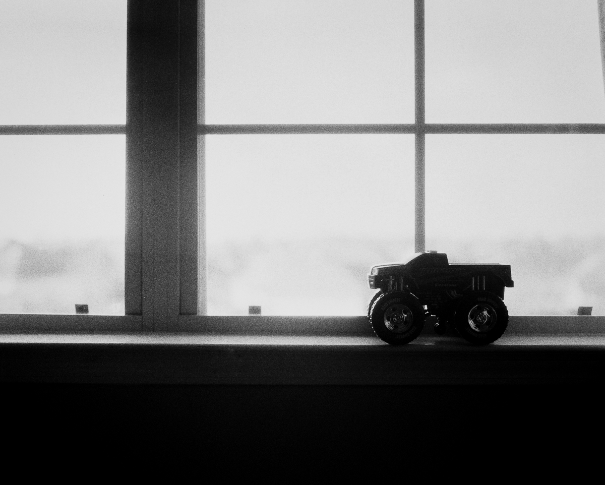 silhouette of toy monster truck in black and white on ilford 3200 by megan cieloha