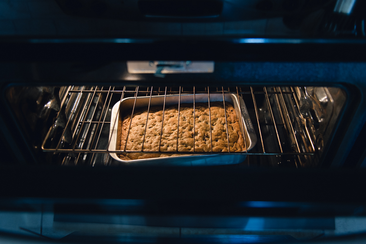 chocolate chip bar cookies in the oven by megan cieloha