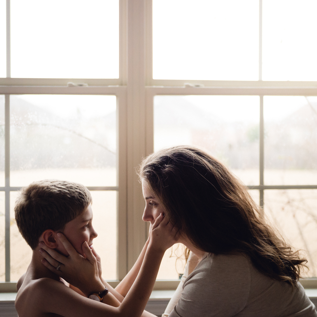 self portrait with boy by megan cieloha in window light