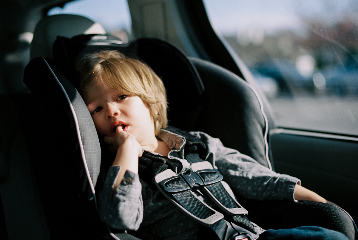 portrait of child in car seat on portra 400 by megan cieloha