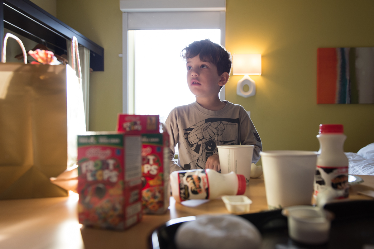 young boy with breakfast cereal by megan cieloha