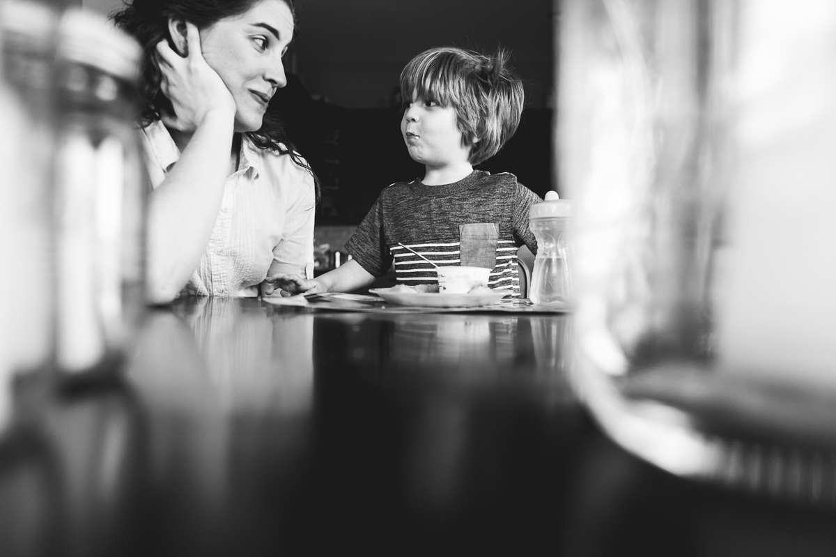self portrait with young child during lunch in black and white by megan cieloha
