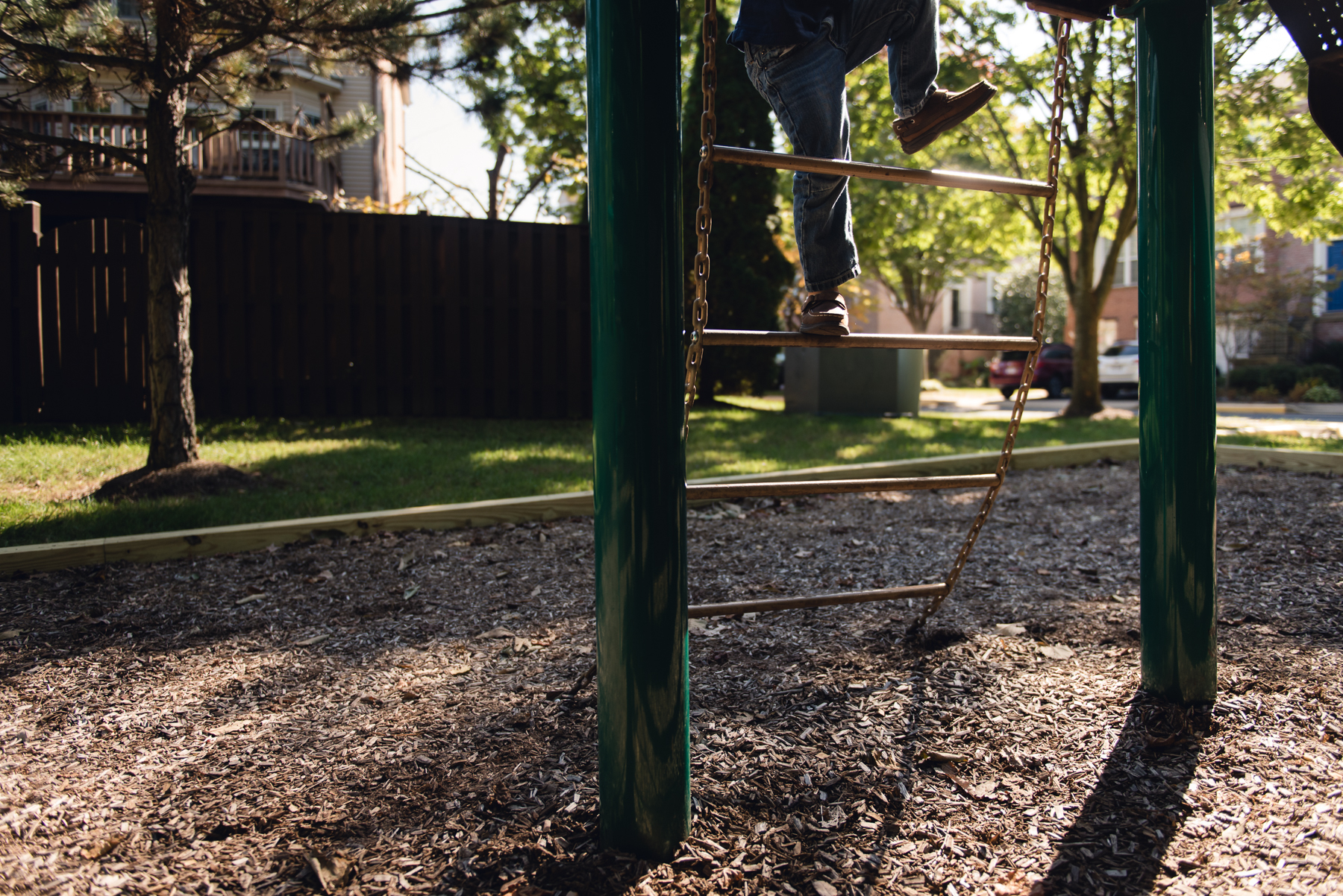 picture of child climbing ladder on a playground by megan cieloha