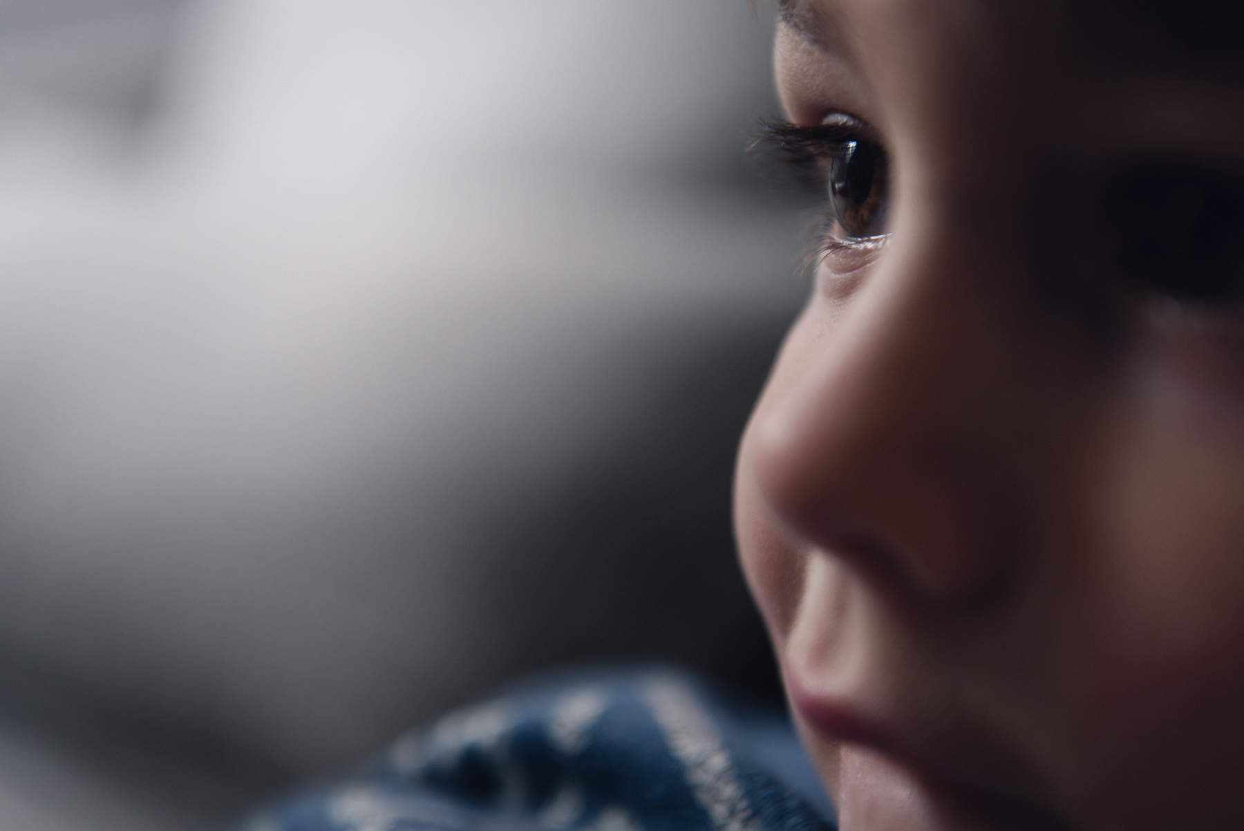 close up portrait of child's face in natural light by megan cieloha