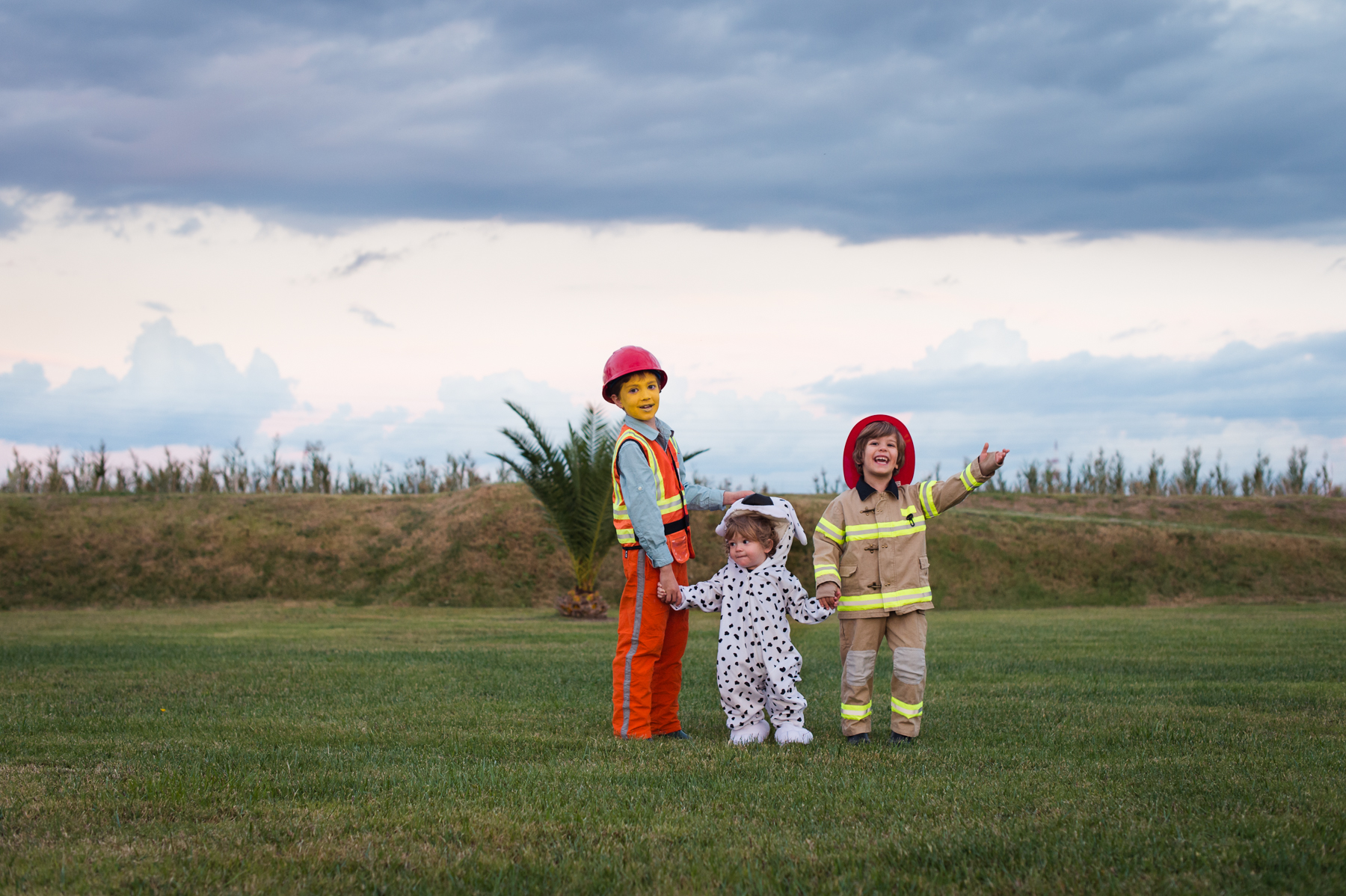 photo of children in halloween costumes by megan cieloha